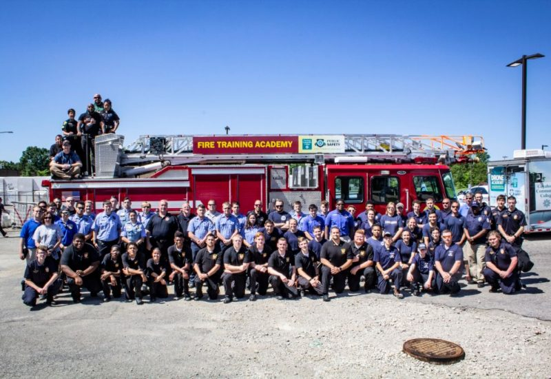 Large group of Explorers with fire truck.