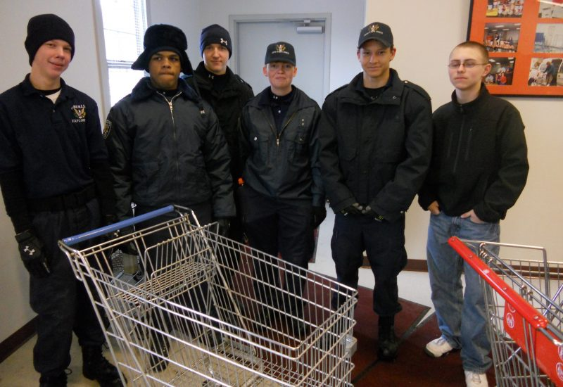 Explorers standing with shopping cart